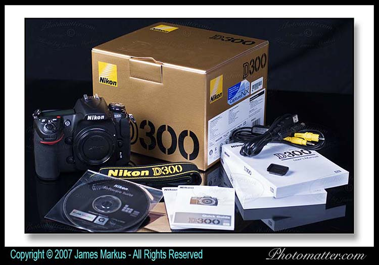 Photo of Nikon D300 box has camera body, software CD, neck strap, battery, charger, Nikon D300 manual, cables and quick guide